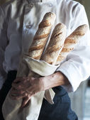 Chef with Fresh Baguette — Stock Photo