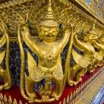 Golden Garuda sculptures vanishing point in Wat Phra Kaew temple, Bangkok. — Stock Photo