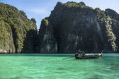 Phi phi island lagoon with a long tail boat — Stock Photo