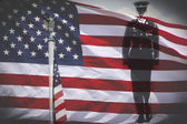 Iron bald eagle, soldier silhouette and an US National flag. — Stock Photo