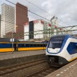 Trains at the central station of The Hague, Dutch governmental c - Stock Photo