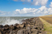 Waves near a Dutch breakwater with Windturbines — Stock Photo
