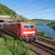 Train leaving a tunnel near the river Moselle in Germany — Stock Photo #13590748
