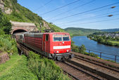 Train leaving a tunnel near the river Moselle in Germany — Stock Photo
