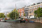 City view of historic Amsterdam, seen from river Amstel — Stock Photo
