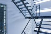 Emergency exit by a stairwell in a modern building — Stock Photo