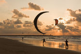 Kitesurfing in the evening at a Dutch beach — Stock Photo