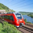 Intercity train leaving a tunnel near the river Moselle in Germany — Stock Photo