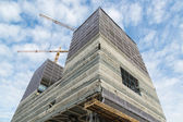 Working place with skyscraper under construction — Stock Photo