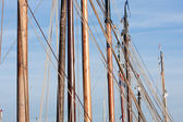 Masts and rigging from old wooden sailing ships — Stock Photo