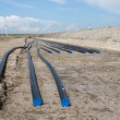 Stock Photo: Digging of big electricity cable trench for big new windfarm