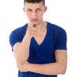 Angry young man pointing a finger towards you, isolated on white — Stock Photo #24680565