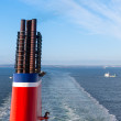 Chimney at a ship sailing a a blue sea - Stock Photo