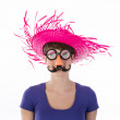 Woman with funny carnival mask and hat — Stock Photo #25168229