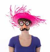Woman with funny carnival mask and hat — Stock Photo