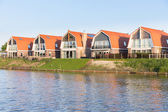 Small houses along a Dutch channel — Stock Photo