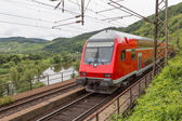 Train driving along river Moselle in Germany — Stock Photo