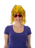 Woman with funny yellow wig and red sunglasses — Stock Photo