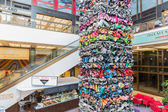 BERLIN, GERMANY - JULY 24: Modern art of metal garbage pieces in a shopping mall near the Friedrichstrasse in the center of Berlin on July 24, 2013 in Berlin, Germany — Stock Photo