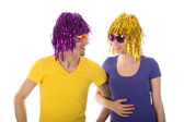 Happy man and woman with wigs and sunglasses — Stock Photo