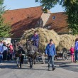NIEUWEHORNE, THE NETHERLANDS - SEP 28: Farmers with a traditional hay-wagon in a countryside parade during the agricultural festival Flaeijel on September 28, 2013, the Netherlands — Stock Photo
