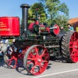 Stock Photo: NIEUWEHORNE, THE NETHERLANDS - SEP 28: Old steam tractor in a countryside parade during the agricultural festival Flaeijel on September 28, 2013, the Netherlands