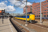 Train leaving Dutch station of Amersfoort — Stock Photo