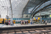 BERLIN, GERMANY - JULY 22: Unknown commuters are waiting for the train at the central station of Berlin on July 22, 2013 in Berlin, Germany — Stock Photo