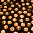 Large group of burning candles at a black background — Stock Photo