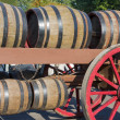 Wooden barrels at an old farm wagon in a countryside parade — Stock Photo