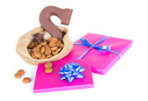 Jute bag with chocolate, ginger nuts and presents, a Dutch tradition at Sinterklaas event in december — Stock Photo