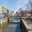 GOTEBORG, SWEDEN - APRIL 26: Unknown people shopping in the center of the city Goteborg with a canal on April 26, 2013 in Goteborg, Sweden — Stock Photo