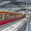 BERLIN, GERMANY - JULY 25: Unknown commuters are traveling by train at the central station of Berlin on July 25, 2013 in the central station of Berlin, Germany — Stock Photo