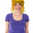 Pretty woman with yellow carnival wig — Stock Photo