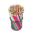 Colorful pencils in a black basket over a white background — Stock Photo #39018117