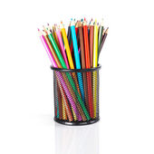 Colorful pencils in a black basket over a white background — 图库照片
