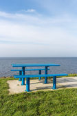 Steel picnic table at Dutch coast with room for copy space — Stockfoto