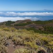 Volcanic landscape of La Palma with a view at Tenerife 100 kilometer away over the ocean — Stock Photo #43103709