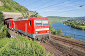 Train leaving a tunnel along river Moselle in Germany — Stok fotoğraf