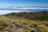 Volcanic landscape of La Palma with a view at Tenerife 100 kilometer away over the ocean — Stock Photo