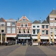 Постер, плакат: Townscape with people sitting on terraces of Delft the Netherlands
