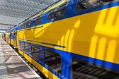 Big yellow train at a Dutch railway station — Stock Photo