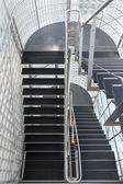 Steel stairway in a modern office building — Stock Photo