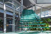 Glass stairway in a modern office building — 图库照片