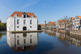 Cityscape of Delft with historic houses and army museum, the Netherlands — Stock Photo