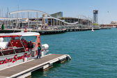 Harbor Barcelona with tourists and a tourist vessel — Photo
