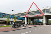 Travellers are waiting at bus stop near a Dutch railway station — Stockfoto