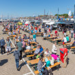 Постер, плакат: Tourists visiting the fishing days of Urk the Netherlands