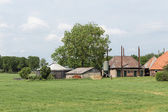 Dutch rural landscape with old farmhouse — Стоковое фото