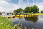 Barrage in Dutch river Vecht with floating barricade — Stock Photo